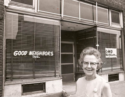 Good Neighbors founder in front of first location